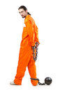 Criminal in orange robe in prison Royalty Free Stock Images