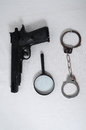 Criminality concept gun and handcuffs on a white background Stock Images
