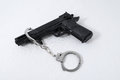 Criminality concept gun and handcuffs on a white background Royalty Free Stock Photography