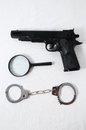 Criminality concept gun and handcuffs on a white background Royalty Free Stock Photo