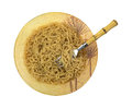Crinkled noodle soup beef broth a large bowl of noodles with and fork on white Stock Photo