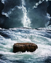 Crisis rock in raging ocean Royalty Free Stock Photo