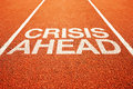 Crisis ahead warning on athletics all weather running track Stock Photo