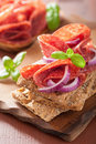 Crisp bread with salami and red onion Royalty Free Stock Photo