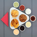 Crisp and dip selection party food in porcelain bowls Royalty Free Stock Photography