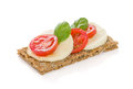 Crispbread with caprese tomato and mozzarella Stock Photo