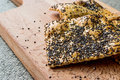 Crispbread with chia seeds and sesame on wooden surface. Royalty Free Stock Photo