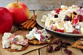 Crisps with autumn topping of chicken, apples, nuts and cranberries Royalty Free Stock Photo