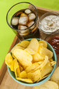 Crisps and coke glass of potato ketchup mayonnaise on bamboo tray Stock Photography