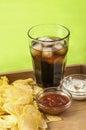 Crisps and coke glass of potato ketchup mayonnaise on bamboo tray Stock Photo