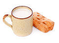 Crispy bun and mug of milk isolated on white Stock Photos