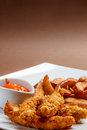 Crispy chicken breast strips with sauce Royalty Free Stock Photos