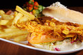 Crispy chicken burger on plate Royalty Free Stock Photography