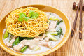 Crispy fried noodle with pork soaked in gravy and kale Stock Images