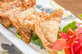 Crispy gau gee pork shrimp and vegetables deep fried in wonton wrappers Royalty Free Stock Photos