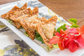 Crispy gau gee pork shrimp and vegetables deep fried in wonton wrappers Stock Photo