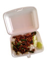 Crispy pork with Basil fried rice in foam box on white backgroun