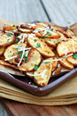 Crispy potato slices with parsley and parmesan cheese Royalty Free Stock Image