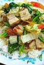 Crispy roasted pork stir fry with vegetables and rice Royalty Free Stock Images