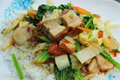 Crispy roasted pork stir fry with vegetables and rice Stock Images