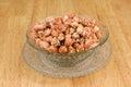 Crispy sugared peanut with sesame on dish crystal Royalty Free Stock Photo