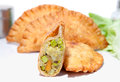 Crispy vegetable samosa filling with boiled pea patatos carrot cauliflower serve on plate Stock Images