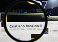 Cristiano ronaldo photo of s official facebook page on a monitor screen through a magnifying glass Stock Image
