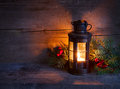 Cristmas lantern in night on old wooden background focus on the wick candles Stock Photography