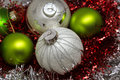 Cristmas and New Years decoration in silver and green on red background Royalty Free Stock Photo