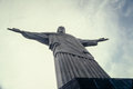Cristo redemptor statue rises on mountain rio de janeiro brazil high into the sky a in Royalty Free Stock Images