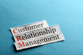 Crm abbreviation customer relation management on blue paper Royalty Free Stock Image