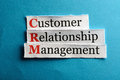 Crm abbreviation customer relation management on blue paper Royalty Free Stock Photos