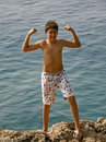 Croatian boy in bikini shows her strength Stock Photo
