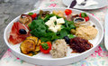 Croatian meze lunch consisting of local feta cheese humus tuna salad pickled mackerel parma ham marinated eggplant and onion Royalty Free Stock Photo