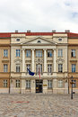 Croatian parliament with flags of european union and croatia Royalty Free Stock Photo
