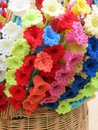 Crochet flowers various colors in wicker Royalty Free Stock Photo