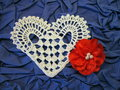 Crochet heart two hearts and red ribbon on blue background Stock Photos