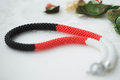 Crochet necklace of red, white and black color Royalty Free Stock Photo