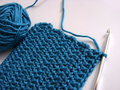 Crochet pattern and hook blue Royalty Free Stock Images