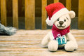 crochet teddy bear in a red Christmas hat.amigurumi handmade. Royalty Free Stock Photo