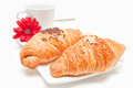 Croissant breakfirst two pieces cup of cafe and red flower breakfast concept Royalty Free Stock Photography