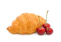 Croissant with a cherry Stock Photo
