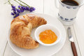 Croissant and coffee breakfast on a whitewashed table Royalty Free Stock Photo