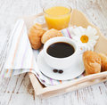 Croissant with coffee cup of and orange juice Royalty Free Stock Images