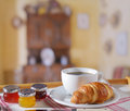 Croissant with coffee and jam on a tray Royalty Free Stock Images