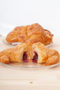 Croissant French brioche filled with berries jam Stock Images