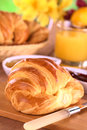 Croissant fresh pastry jam fruits and orange juice for breakfast selective focus focus one third into the Stock Images