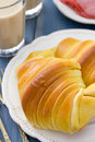 Croissant with ham on plate and glasses of coffee Royalty Free Stock Photo