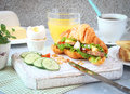 Croissant ham sandwich with fresh lettuce, egg, tomato, cucumber Royalty Free Stock Photo