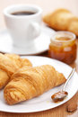 Croissant with jam for breakfast Stock Photography